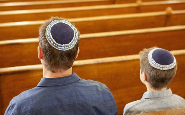 Illustrative: Jewish people at a synagogue. ((Robert Nicholas/Getty Images via JTA)