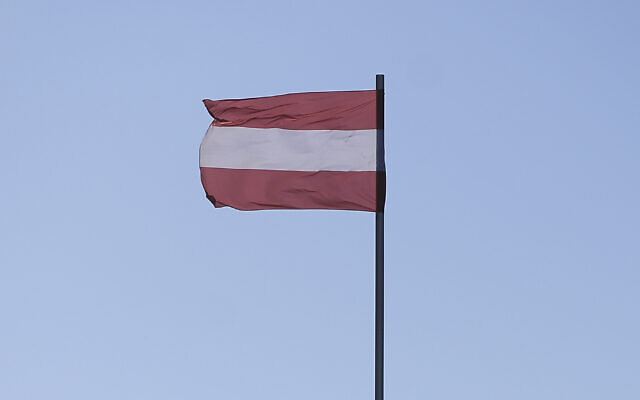 An Austrian flag is seen flying in Hofburg Palace in Vienna. (Photo by Omar Marques / SOPA Images/SOPA Images/LightRocket via Getty Images/JTA)
