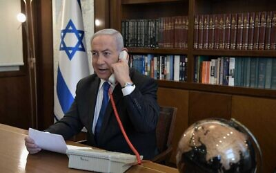 Prime Minister Benjamin Netanyahu at his office in Jerusalem on a phone call with UAE leader Mohammed Bin Zayed, on August 13, 2020. (Kobi Gideon/PMO)