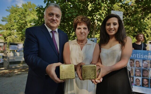 Laura Kam (center), with her husband Amb. Jeremy Issacharoff (R) and daughter Ella at the Stolpersteine (Stumbling Stone) ceremony memorializing Kam's great-grandparents, Rosa and Abraham Hacker, in Dortmund, Germany Aug. 10, 2020 (Courtesy)