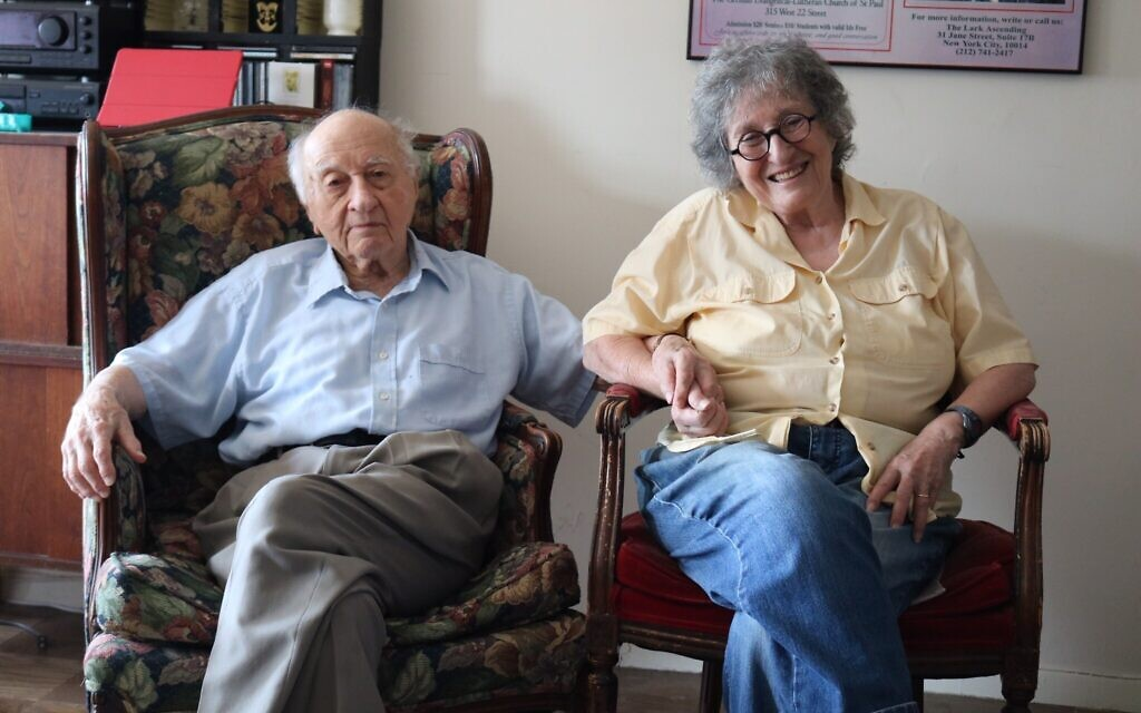 Arnold Greissle, 97, with wife Nancy Bogen, 88, in their New York apartment, 2020. The couple are regular members of the Stammtisch, where Arnold's Viennese potato salad is a must-have each week. (Hannah Harnest/ Times of Israel)