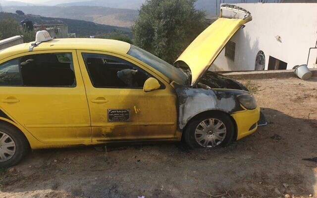 A torched car in the Palestinian village of Fara'ata in the northern West Bank in a suspected hate crime, August 4, 2020. (Fara'ata local council)