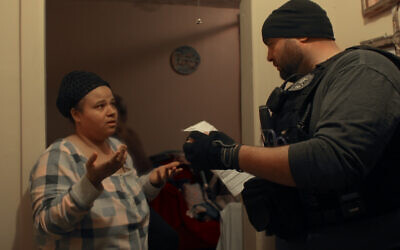 An ICE officer makes an arrest at a New York home in Episode 1 of Netflix's 'Immigration Nation.' (Courtesy of NETFLIX © 2020)