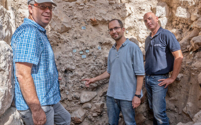 From left-right: Prof. Yuval Gadot, TAU PhD student Yoav Vaknin, IAA archaeologist Dr. Yiftach Shalev at the site where remnants of the 586 BCE destruction of Jerusalem by the Babylonians were discovered in the City of David Park in Jerusalem. (Shai Halevi/Israel Antiquities Authority)