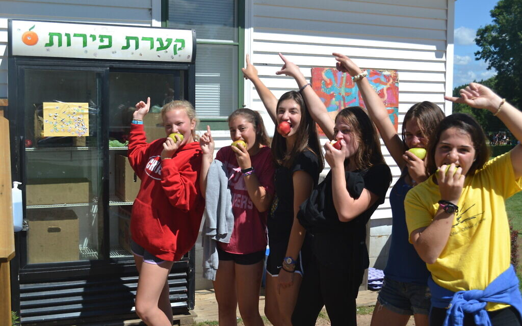 Campers have a snack at 'Ke'arat Peirot' (Fruit Bowl) at Camp Ramah in Wisconsin. (Courtesy of authors)