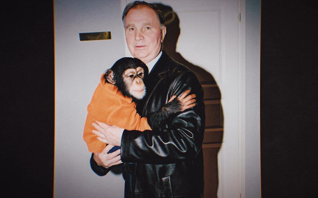 Legendary Soviet coach Viktor Tikhonov holding a chimpanzee. (Courtesy Universal Pictures Entertainment)
