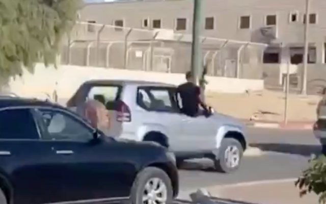 A convoy rides through the southern town of Segev Shalom with its passengers firing automatic weapons into the air, in footage released by Channel 13 on August 1, 2020. (Screen capture/Twitter)