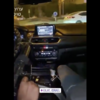 In a  video circulated online, two unidentified men can be seen driving around Eilat with a loaded M-16 belonging to an IDF serviceman. (Screenshot)