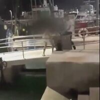 A screen capture from video of a suspected homophobic assault at the Jaffa Port on August 1, 2020. (Screen capture: Twitter)