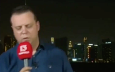 Channel 13's Doron Herman faints on air while reporting from Dubai on August 16, 2020. (Screen capture/ Twitter)