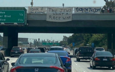 A sign bearing the slogan, 'Honk if you know the Jews want a race war' placed on an overpass on route I-405 in Los Angeles by Jon Minadeo Jr. of the Goyim Defense League. (Siamak Kordestani/Twitter via JTA)