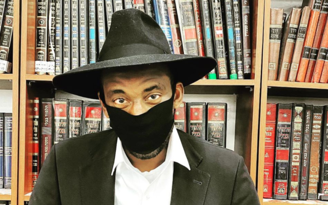 Amar'e Stoudemire in a yeshiva, wearing the black and white clothing associated with certain Orthodox Jews. (Amar'e Stoudemire/Instagram via JTA)