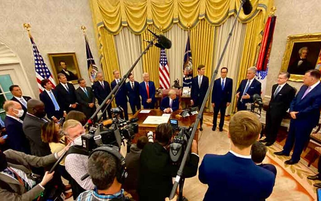 US President Donald Trump, with key administration officials around him in the Oval Office, announces that the United Arab Emirates and Israel have agreed to establish full diplomatic ties, August 13, 2020. (White House via Twitter)