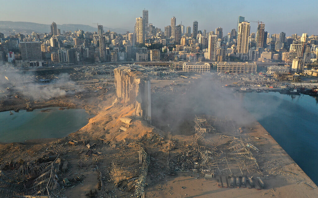 A drone picture shows the scene of an explosion at the seaport of Beirut, Lebanon, August 5, 2020. (AP Photo/Hussein Malla)