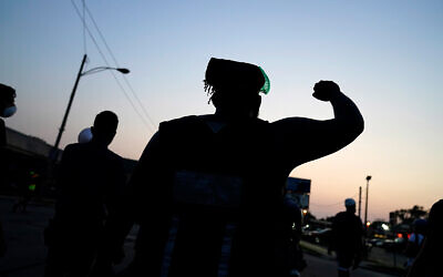 Protesters march against the police shooting of Jacob Blake in Kenosha, Wisconsin, August 26, 2020. (AP Photo/David Goldman)