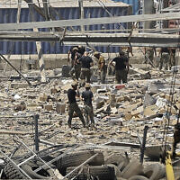 Rescuers and civil defense members search through the debris at Beirut port, August 5, 2020. (Joseph Eid/AFP)