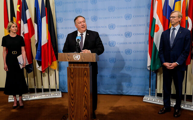 US Secretary of State Mike Pompeo speaks to reporters following a meeting with members of the UN Security Council, with US Ambassador to the UN Kelly Craft, left, and US Special Representative for Iran Brian Hook, right, at the United Nations, August 20, 2020. (Mike Segar/Pool via AP)
