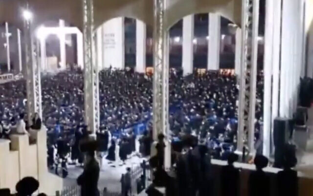 A screenshot from a video said to show thousands of ultra-Orthodox at a wedding in Jerusalem, in violation of coronavirus restrictions, on August 5, 2020. (Screenshot/Channel 12)
