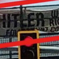 "A banner reading ""Hitler was right"" on a bridge in Arizona. (Screenshot/KPNX 12News)"