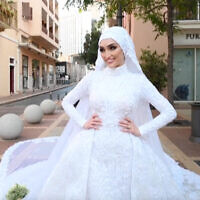 Dr. Israa Seblani during her wedding photo shoot moments before the Beirut blast tore through the city. (Screenshot/Mahmoud Nakib via AFP)