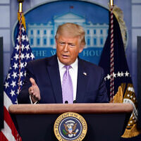 US President Donald Trump speaks at a news conference at the White House in Washington, August 13, 2020, after announcing Israel and the UAE were fully normalizing their ties. (AP Photo/Andrew Harnik)