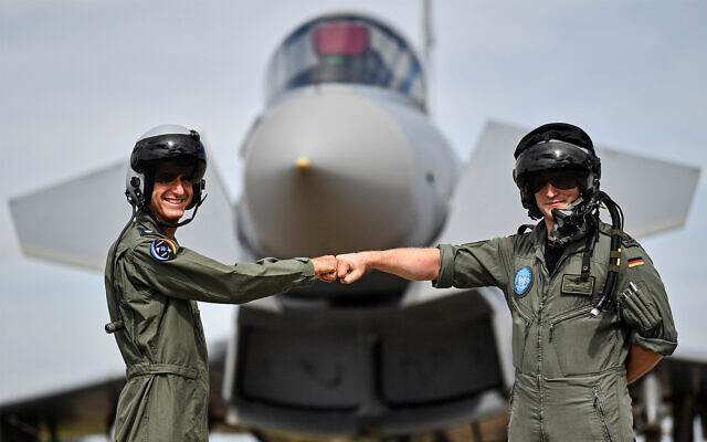A pilot from Israel, left, and a pilot from Germany, right, pose in front of a Eurofighter at an airbase in Noervenich, Germany, August 20, 2020. (AP Photo/Martin Meissner)