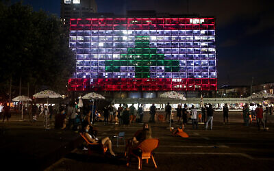Tel Aviv municipality in Rabin square is lit up with the Lebanese flag in solidarity with the victims of the the Beirut port explosion, August 5, 2020. (Miriam Alster/Flash90)