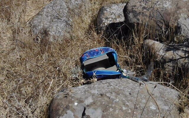 A bag with explosive devices inside it is seen near the scene where four Syrian suspects were killed Sunday night, after crossing the border and planting bombs, August 3, 2020. (Israel Defense Forces)