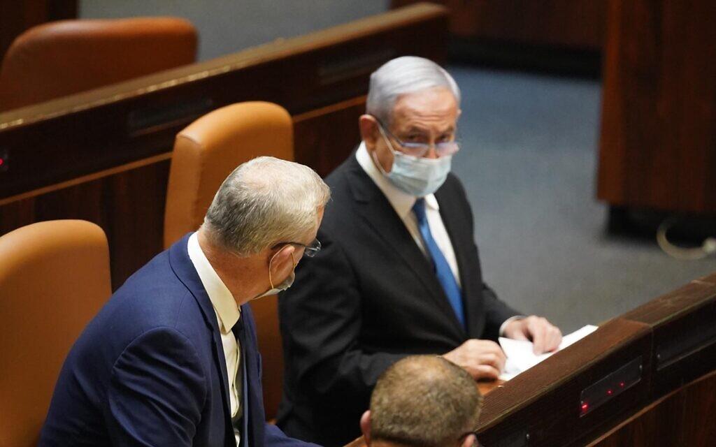 Defense Minister Benny Gantz (L) and Prime Minister Benjamin Netanyahu in the Knesset plenum on August 24, 2020. (Knesset Spokesperson's Office)