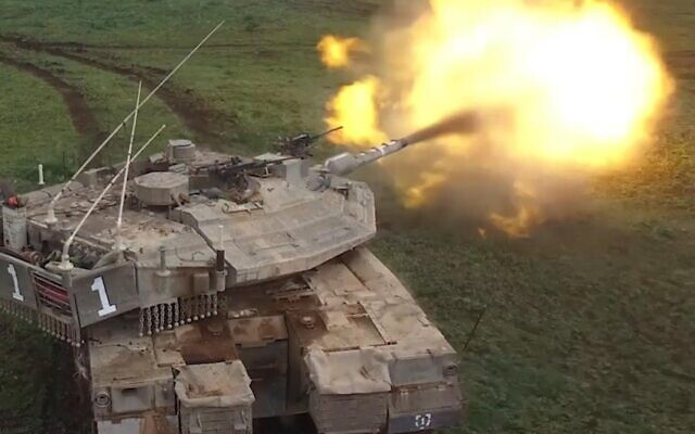 An IDF tank is seen firing a shell during an exercise in an undated photograph. (Israel Defense Forces)