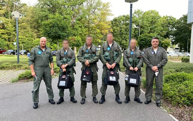 Israeli Air Force commander Amikam Norkin, right, German Air Force Commander Ingo Gerhartz, left, and five IAF pilots pose for a photograph before taking part in a flyby over Munich and the Dachau concentration camp on August 18, 2020. (Israel Defense Forces)