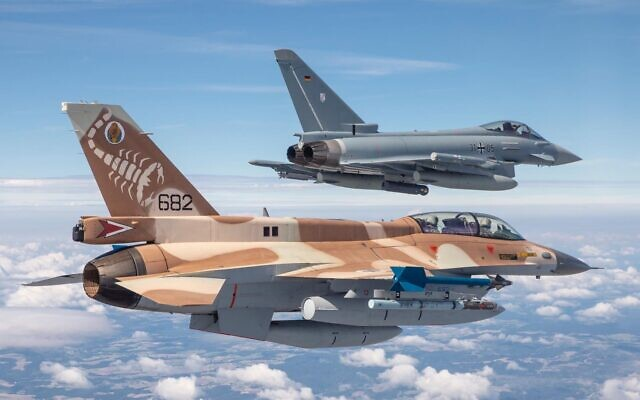 A German air force Eurofighter and an Israeli Air Force F-16 jet fly in formation near Munich in commemoration of the 1972 Munich Olympic Games massacre in which 11 Israeli athletes were killed, on August 18, 2020. (Israel Defense Forces)