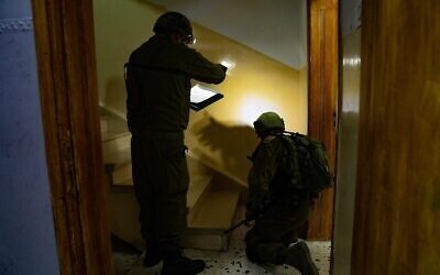 Israeli troops in the northern West Bank village of Rujeeb measure the home of a suspected Palestinian terrorist who allegedly stabbed to death an Israeli man the day before, on August 27, 2020. (Israel Defense Forces)