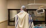 Defense Minister Benny Gantz prays at Tel Hashomer's Sheba Medical Center before back surgery on August 12, 2020 (Courtesy),