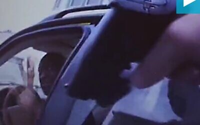 A still from the police bodycam video showing an officer pointing his gun at George Floyd (Screencapture/Daily Mail)