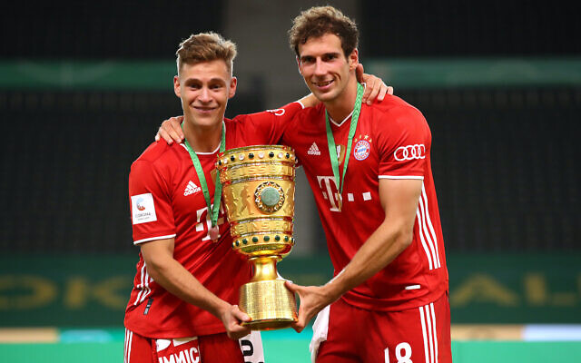 Joshua Kimmich, left, and Leon Goretzka of FC Bayern Munich celebrate after winning the DFB Cup at the Olympiastadion in Berlin, July 4, 2020. (Alexander Hassenstein/Getty Images via JTA)
