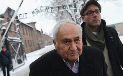 Hungarian-born Auschwitz survivor Gabor Hirsch visits the former Auschwitz I concentration camp, which is now a museum, on January 26, 2015 in Oswiecim, Poland. (Sean Gallup/Getty Images via JTA)