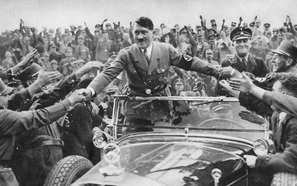 Adolf Hitler takes in adulation from the crowd (public domain)