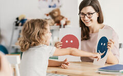 Emotion emoticons used by a psychologist during a therapy session with a child with an autism. (iStock)