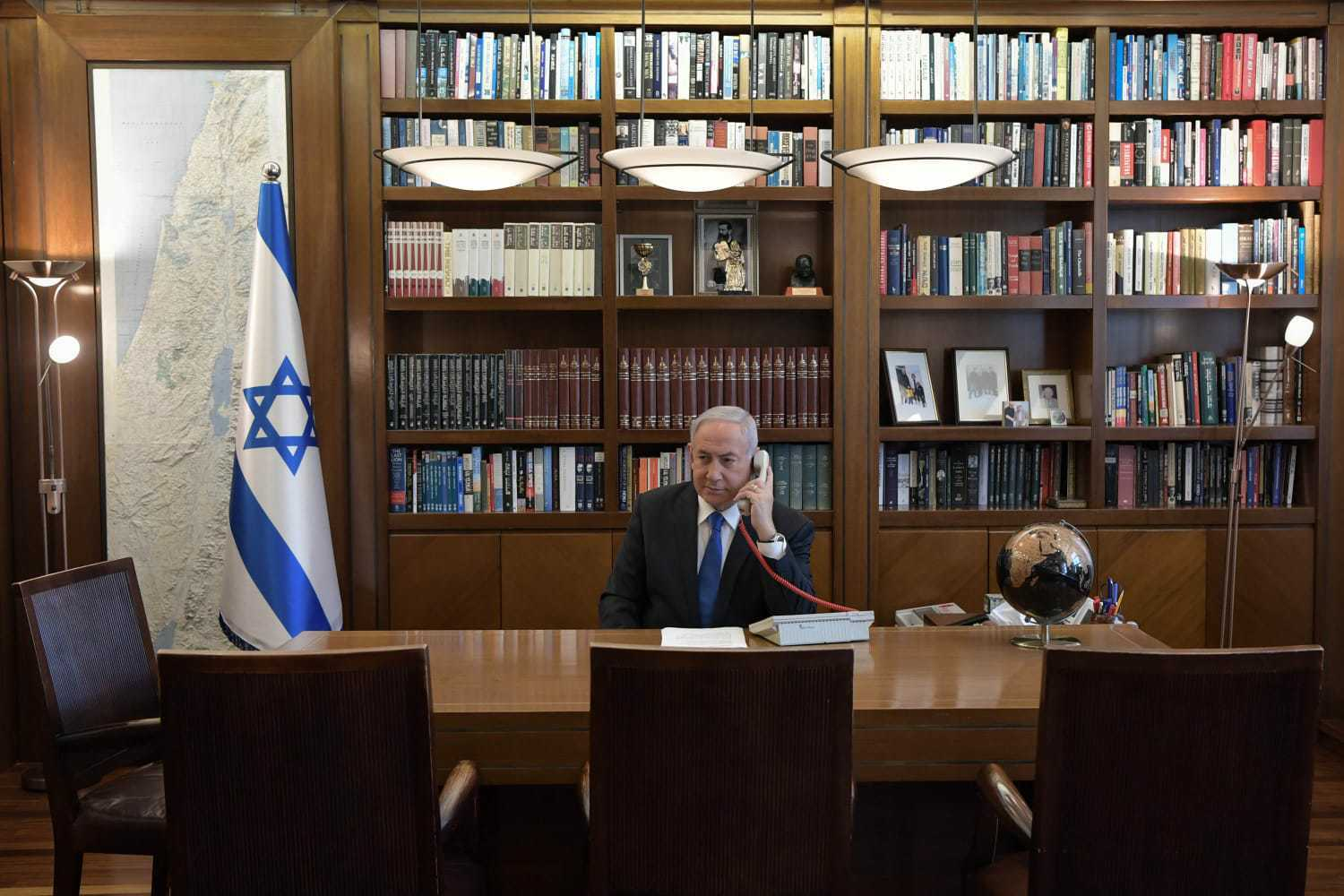 Prime Minister Benjamin Netanyahu at his office in Jerusalem on a phone call with UAE leader Mohammed Bin Zayed on August 13, 2020. (Kobi Gideon/PMO)