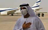 An Emirati official stands near an El Al plane that carried a US-Israeli delegation to the UAE following a normalization accord, upon its arrival at the Abu Dhabi airport, in the first-ever direct flight from Israel to the UAE, on August 31, 2020. (KARIM SAHIB / AFP)