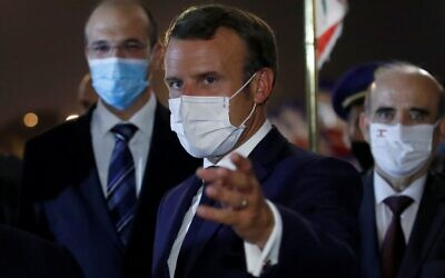 Illustrative: French President Emmanuel Macron wears a mask due to the COVID-19 pandemic upon arrival at Beirut International airport, on August 31, 2020. (Photo by GONZALO FUENTES / POOL / AFP)