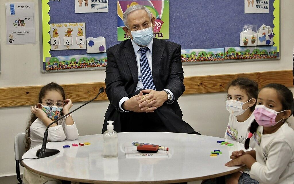 Prime Minister Benjamin Netanyahu meets schoolchildren as he attends a ceremony to mark the start of the school year in Mevo Horon on September 1, 2020. (Marc Israel Sellem/Pool/AFP)