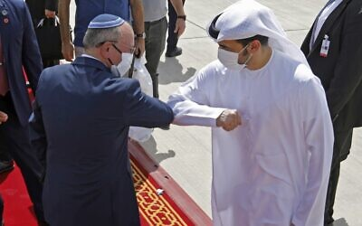 National Security Adviser Meir Ben-Shabbat elbow bumps with an Emirati official ahead of boarding the plane before leaving Abu Dhabi, United Arab Emirates, September 1, 2020. (Nir Elias/Pool/AFP)
