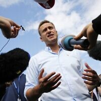 This file photo taken on July 20, 2019 shows Russian opposition leader Alexei Navalny speaking with journalists during a rally to support opposition and independent candidates after authorities refused to register them for September elections to the Moscow City Duma, in Moscow. (Maxim ZMEYEV / AFP)