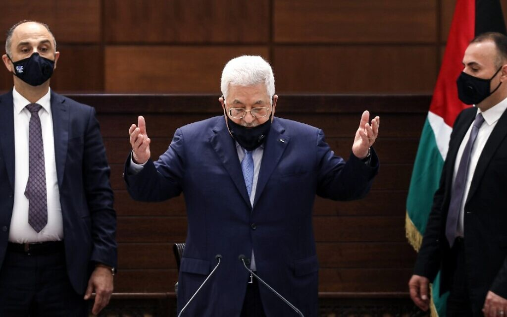 Palestinian Authority President Mahmoud Abbas recites a prayer as he arrives for a meeting in the West Bank's Ramallah on September 3, 2020. (Alaa Badarneh/Pool/AFP)