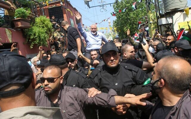 Hamas' political bureau chief Ismail Haniyeh greets supporters during a visit to the Ein el-Hilweh camp, Lebanon's largest Palestinian refugee camp, near the southern coastal city of Sidon on September 6, 2020. (Mahmoud ZAYYAT / AFP)