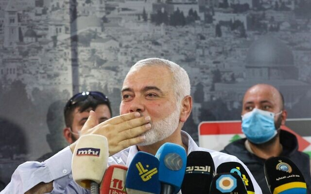 Ismail Haniyeh gestures to supporters before delivering a speech during a visit to the Ein el-Hilweh camp, Lebanon's largest Palestinian refugee camp, near the southern coastal city of Sidon on September 6, 2020. (Mahmoud ZAYYAT / AFP)