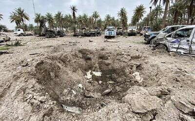 An impact crater in the aftermath of US military air strikes at a militarized zone in the Jurf al-Sakhr area in Iraq's Babylon province (south of the capital) controlled by Hezbollah Biridages, a hardline faction of the Popular Mobilization Forces paramilitaries, March 13, 2020. (Photo by AFP)