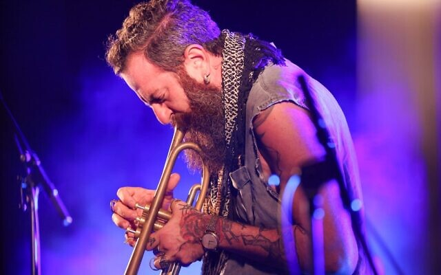 Avishai Cohen, the co-founder and artistic director of the event, performs on stage during the Jerusalem Jazz Festival in Jerusalem on September 8, 2020. (Photo by EMMANUEL DUNAND / AFP)